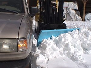 Fork lift plow gets into tight spots